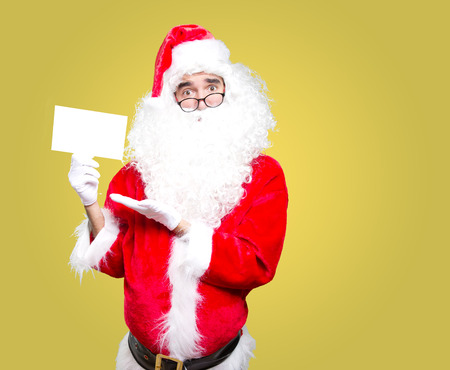 Happy Santa Claus holding a letter