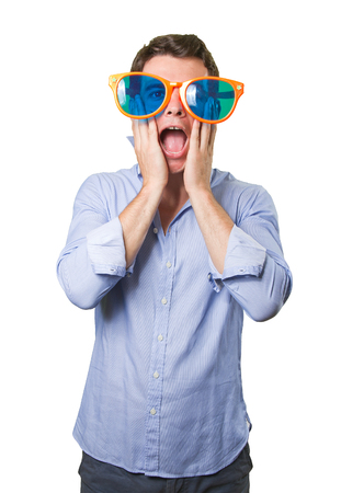 cool guy: Surprised cool guy with a toy glasses on white background Stock Photo