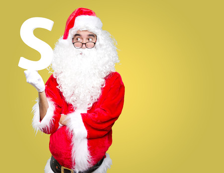 hat new year s eve: Surprised Santa Claus holding a S Stock Photo