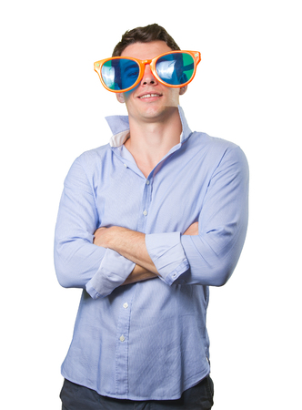 cool guy: Satisfied cool guy with a toy glasses on white background Stock Photo