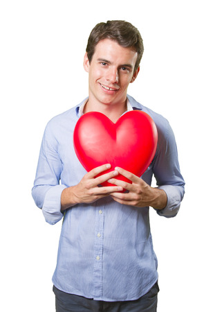 doctor holding gift: Happy young man in love on white background