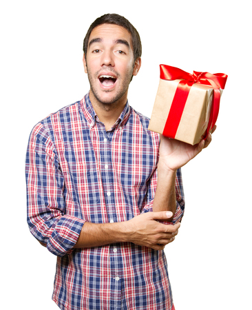 Happy young man holding a gift