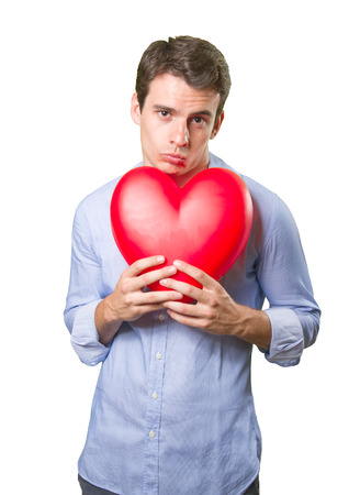 doctor holding gift: Romantic young man sending a kiss on white background