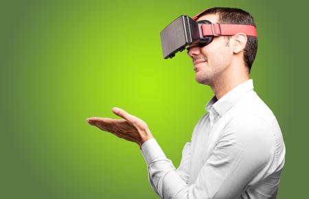 virtual reality simulator: Young man using a virtual glasses