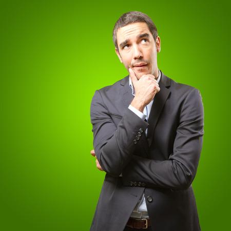 businessman thinking: Concerned businessman thinking