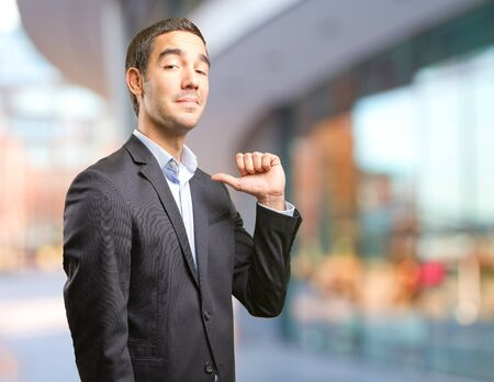 in vain: Satisfied young businessman Stock Photo