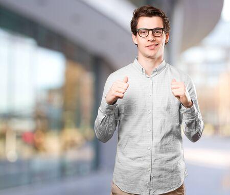 in vain: Happy young man posing