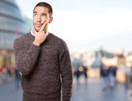 Young man doing a doubt gesture Stock Photo