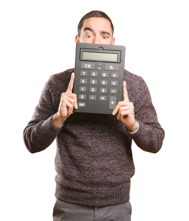 Surprised young man holding a calculator