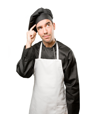 Puzzled young chef wondering