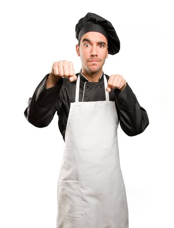 Angry chef doing a fight gesture