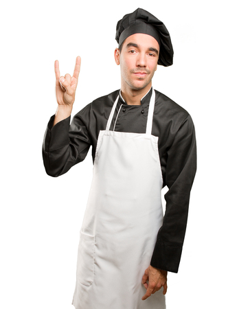 Cool young chef posing Stock Photo