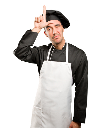 Loser young chef posing Stock Photo