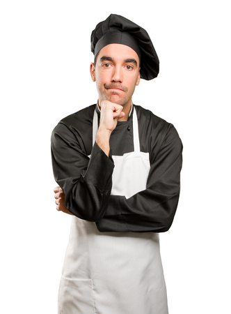 Concerned young chef posing