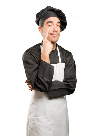 Worried young chef observating Stock Photo