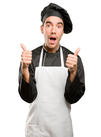 Confident young chef doing an okay gesture Stock Photo
