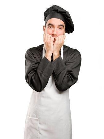 Nervous young chef posing Stock Photo
