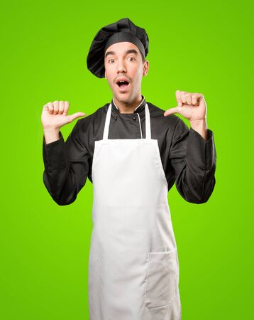 Confident young chef posing Stock Photo