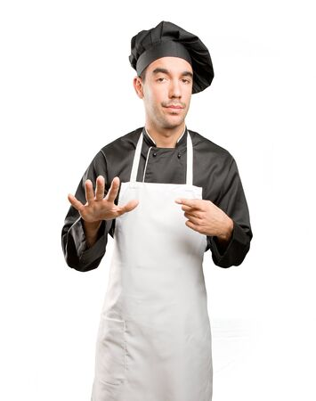 Confident chef with a keep calm gesture Stock Photo