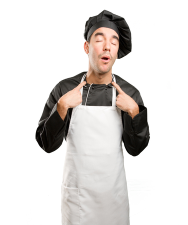 Stressed young chef posing
