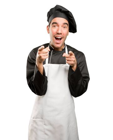 service man: Funny young chef laughing at you Stock Photo