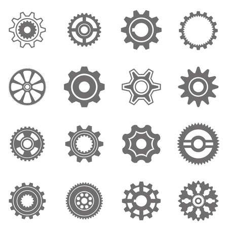 engranes: Conjunto de ruedas dentadas en blanco y negro. Al cambiar el tamaño, los engranajes se pueden combinar en mecanismo.