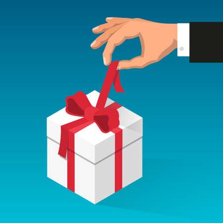 Man hand knoopt rood lint op de doos met gift los.
