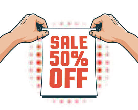 Hands hang up a sale announcement 50% discount Stock Photo