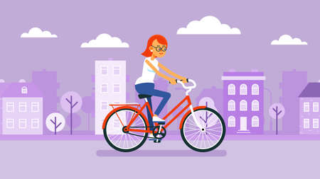 Girl rides bicycle on the cityscape background. Woman cyclist