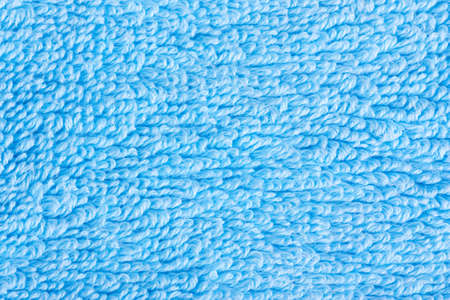 Closeup view of blue towel. Fluffy blue background