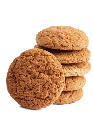 milk and cookies: Closeup view of stack of oatmeal cookies over white background Stock Photo