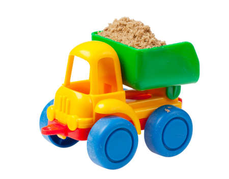 Colorful toy truck with sand isolated over white background photo