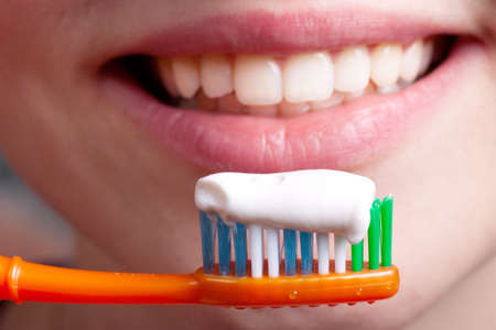 Toothbrush, toothpaste and smiling woman Stock Photo - 11410915