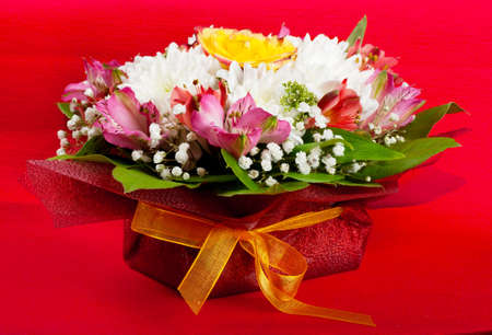 Closeup view of wedding bouquet over red background photo