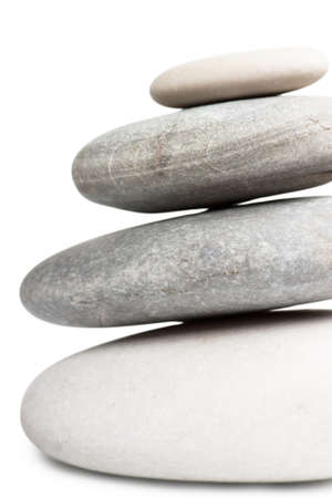 Stack of four round stones isolated over white background photo