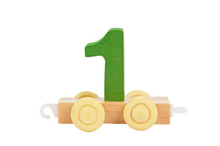 Wooden toy on a wheels number 1 isolated over white