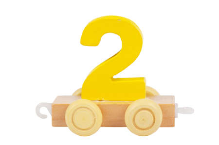 Wooden toy on a wheels number 2 isolated over white photo