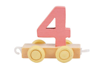 Wooden toy on a wheels number 4 isolated over white photo