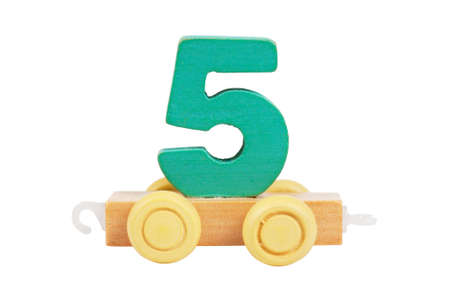 Wooden toy on a wheels number 5 isolated over white photo