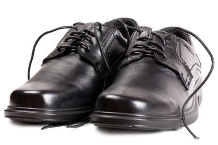 A pair of black shoes with black laces Standard-Bild