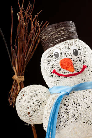 A snowman made of thread over black background photo
