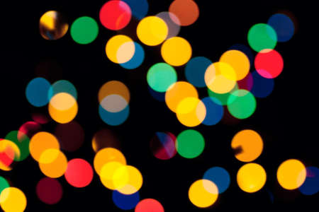 Abstract background with colorful defocused lights over black background Stock Photo - 11836596