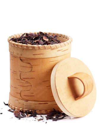 birchen: Birch bark box with red tea inside over white background Stock Photo