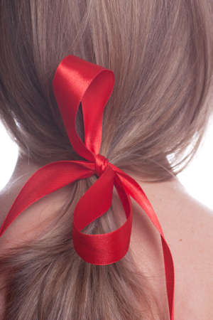 Closeup view of red bow in a womans hair photo