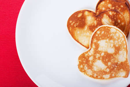 Two heart-shaped pancakes on a plate photo