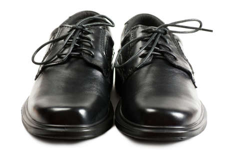 Men black shoes with black laces over white background photo
