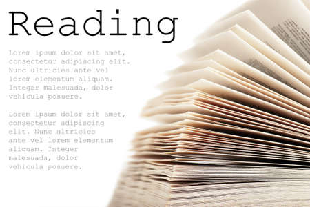 stack of books: Open book isolated over white background Stock Photo