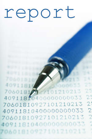 Macro view of blue pen on a report with many digits photo