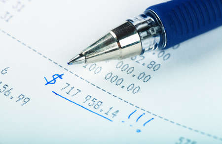 Macro view of blue pen on a business report photo