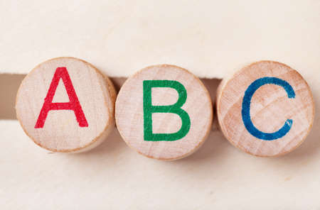 Three alphabet wooden blocks photo